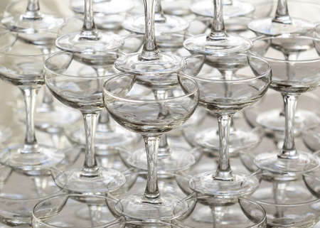 Pyramid holiday of champagne glasses on table in party photo