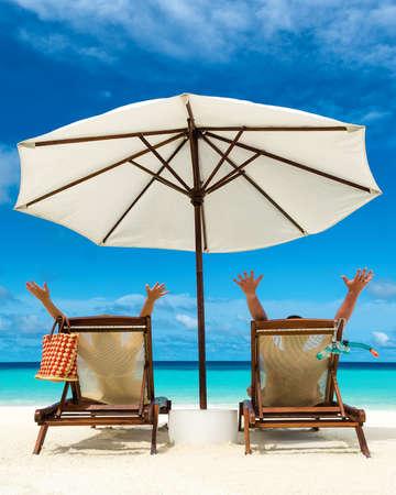 woman chair: Couple on a tropical beach at Maldives