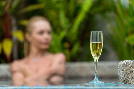 Champagne near swimming pool on a background photo