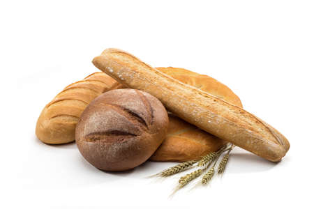 assortment of baked bread in basket on white background