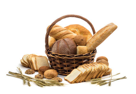 assortment of baked bread in basket on white background photo