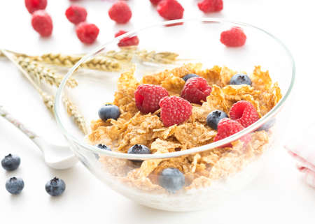 Cereal flakes with fresh raspberry closeup photo