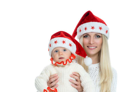 Cute mom and baby in santa hats photo