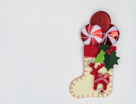 Christmas decorations and sock on white background photo