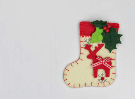 Christmas decorations and sock on white background isolated photo