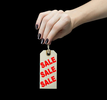 Sale Tag on women hand