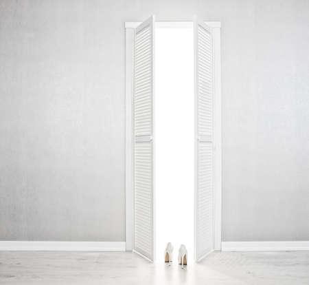 no heels: Womens white shoe near of the open door