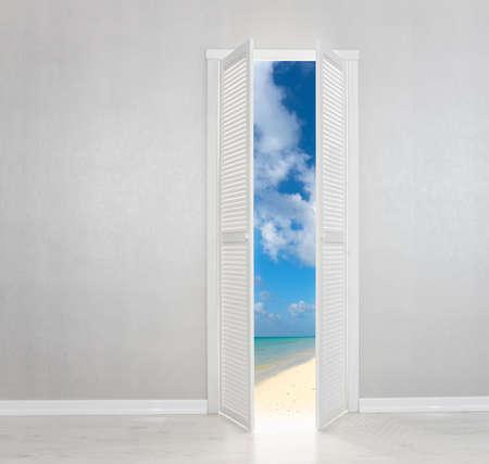 holiday villa: White Door open to the perfect beach Stock Photo