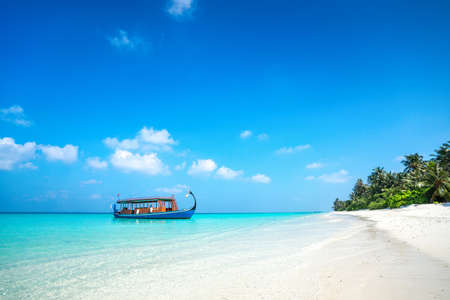 tropical climate: Perfect tropical island paradise beach and boat, Maldives Stock Photo