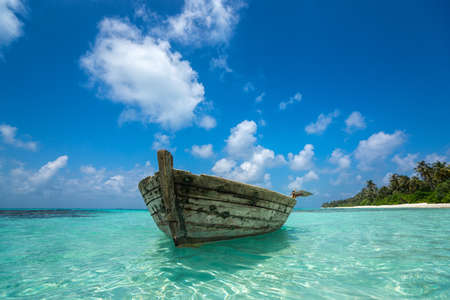 peaceful background: Perfect tropical island paradise beach and old boat