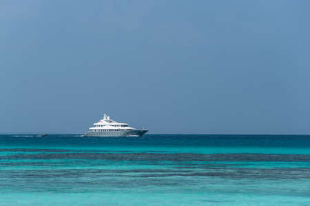 way out: Large private motor yacht under way out at sea