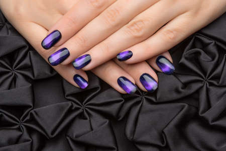 salon background: Beautiful womans nails with nice stylish manicure.