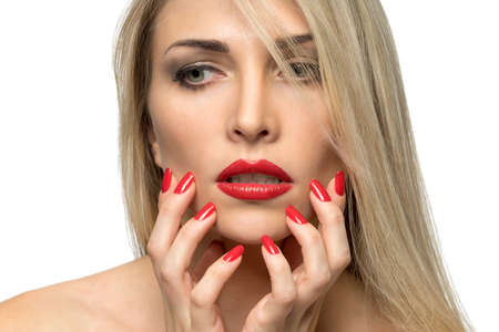 charm temptation: Close-up portrait of sexy woman lips with red lipstick and red manicure