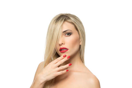 fair complexion: Beautiful Blond Woman Portrait close-up. Hairstyle. Red lips. Manicured nails. Stock Photo