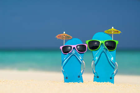 flipflops: flip-flops and sunglasses by the sea
