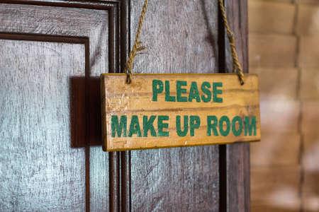room door: Please make up room sign on door knob in hotel Stock Photo