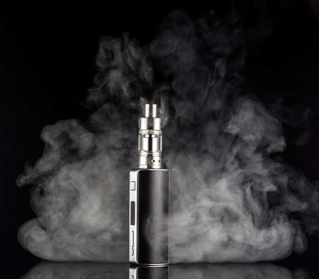 background e cigarette: electronic cigarette over a dark background