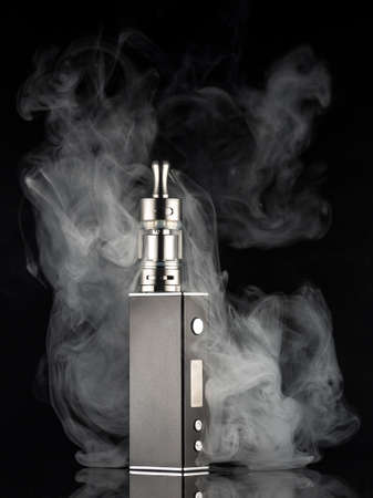 electronic background: electronic cigarette over a dark background