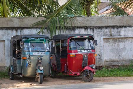 trishaw: BENTOTA, SRI LANKA - DECEMBER 31, 2015: Tuk-tuk moto taxi on the street. Famous thai moto-taxi called tuk-tuk is a landmark of the country and popular transport. Editorial