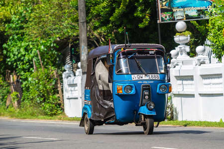 auto rickshaw: BENTOTA, SRI LANKA - DECEMBER 31, 2015: Tuk-tuk moto taxi on the street. Famous thai moto-taxi called tuk-tuk is a landmark of the country and popular transport. Editorial