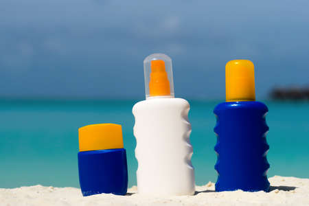 Sunscreen cream bottle on the beach Stock Photo