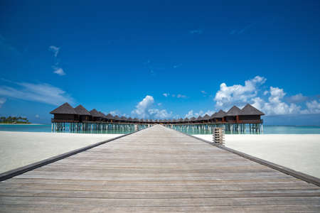 bungalows: Beautiful beach with water bungalows at Maldives Editorial