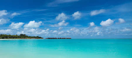 Perfect tropical island paradise beach Maldives, panorama format