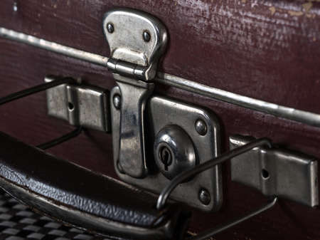 portmanteau: close-up fragment of locks and fasteners on the vintage leather suitcase
