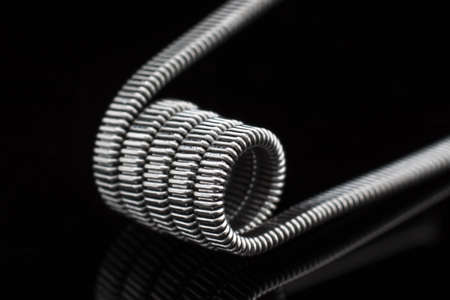 cantal: Multistrand Ribbon Fused Clapton on a dripper gold Stock Photo