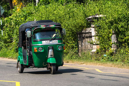 trishaw: MIRISSA, SRI LANKA - January 07, 2017: Tuk-tuk moto taxi on the street. Famous thai moto-taxi called tuk-tuk is a landmark of the country and popular transport.