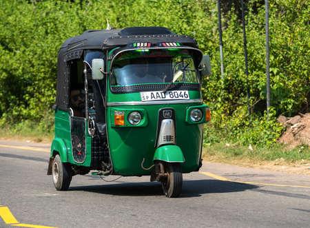 MIRISSA, SRI LANKA - January 07, 2017: Tuk-tuk moto taxi on the street. Famous thai moto-taxi called tuk-tuk is a landmark of the country and popular transport.