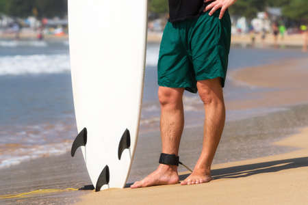 surfboard fin: Young beautiful surfer men on beach with surf board at day break Stock Photo