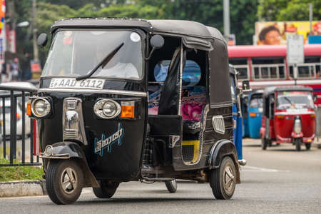 MIRISSA, SRI LANKA - January 01, 2017: Tuk-tuk moto taxi on the street. Famous thai moto-taxi called tuk-tuk is a landmark of the country and popular transport.