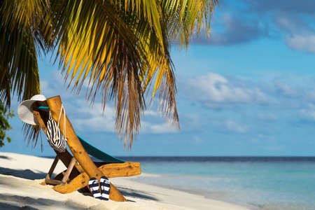 chairs: Picture of wooden beach chairs on the tropical beach, vacation. Traveler dreams concept