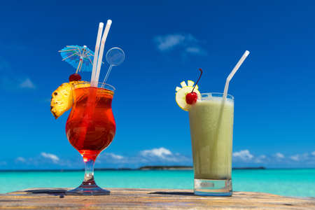 edge: cocktail on the beach. Concept of luxury vacation. Stock Photo