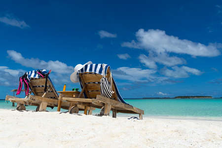Picture of wooden beach chairs on the tropical beach, vacation. Traveler dreams concept