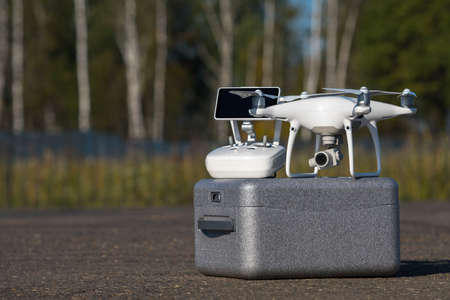 MOSCOW, RUSSIA - 24 September, 2017: a Phantom 4 Pro drone in flight, selective focus on the drone. Phantom 4 Pro is a drone manufactured by the DJI company. Editorial