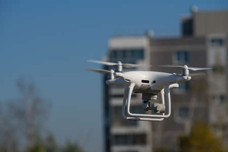 MOSCOW, RUSSIA - 24 September, 2017: DJI Phantom 4 pro quadcopter drone flying with a camera outdoors Editorial