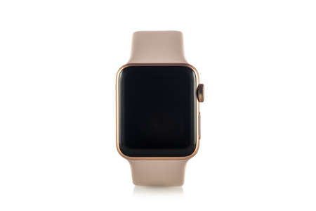 MOSCOW, RUSSIA - OCTOBER 07, 2017: New Apple Watch Series 3 Gold Aluminum Case Pink Sand Sport Band.  Isolated on white background. Apple Watch incorporates fitness tracking and health-oriented capabilities and integration with iOS Apple products and serv Editorial