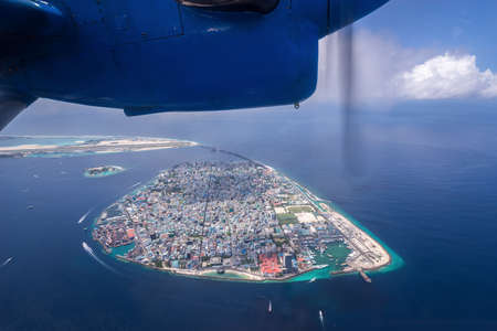 View of Male the capital city of Maldives from seaplane Stock Photo