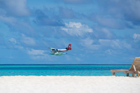 Male, Maldives - June 22, 2017 : Seaplane air taxi fly over Atolls in Indian Ocean To transfer passengers to the hotel in the islands. Sajtókép