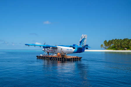 Indian Ocean, Malddives - June 15, 2017: A Maldivian Air Taxi water plain is waiting to accept passengers.