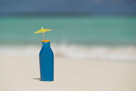 Sunscreen cream bottle on the  tropical beach Stock Photo