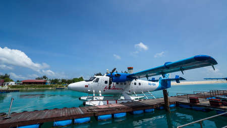 Male, Maldives  - June 15, 2017 : Seaplane air taxi fly over Atolls in Indian Ocean To transfer passengers to the hotel in the islands.