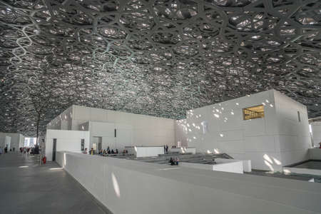 Abu Dhabi, United Arab Emirates,  JANUARY 04, 2018:  Interior of the Louvre Museum, Abu Dhabi, showing reflections of the
