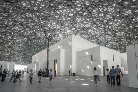 Abu Dhabi, United Arab Emirates,  JANUARY 04, 2018:  Interior of the Louvre Museum, Abu Dhabi, showing reflections of the Rain of Light dome