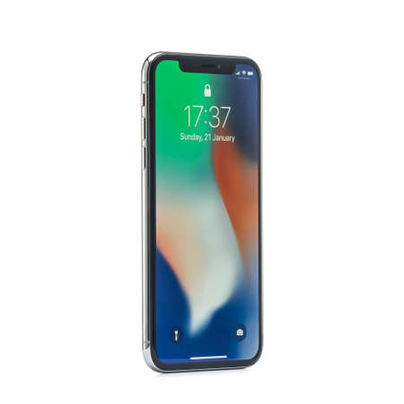 MOSCOW, RUSSIA - jANUARY 06,2018: iPhone X on wooden table. The iPhone X is smart phone with multi touch screen produced by Apple Computer, Inc.