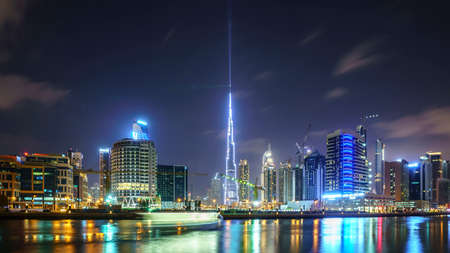 DUBAI,UAE - jANUARY 07,2018:  Downtown summer night skyline. Panoramic view of business bay and downtown area of Dubai reflection in a river. Editorial