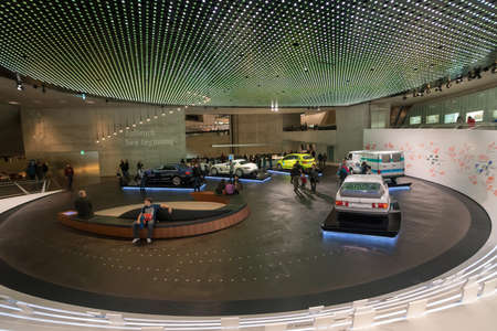 """STUTTGART, GERMANY - DECEMBER 30, 2018: Interior of museum """"Mercedes Benz Welt"""". The museum covers the history of the Mercedes-Benz and the brands associated."""
