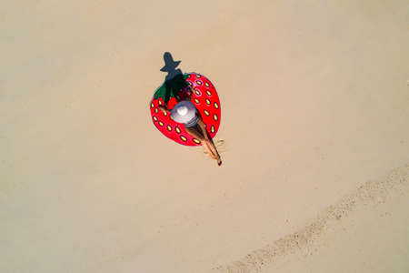 Aerial drone aerial view of Beautiful girl having fun on the sunny tropical beach. Seychelles